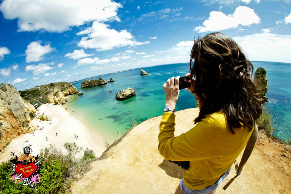 Customer taking a photo from an aerial viewpoint in Dona Ana Lagos on the Portugal Weekend Trip