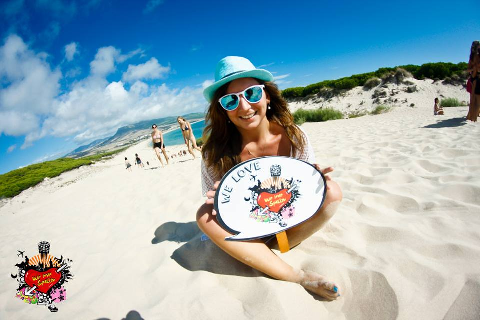 Happy erasmus student at Bolonia beach with We Love Spain